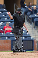 Home plate umpire Reid Churchhill makes a strike call during the NCAA baseball game between the California Golden Bears and the Duke Blue Devils at Durham Bulls Athletic Park on February 20, 2016 in Durham, North Carolina.  The Blue Devils defeated the Golden Bears 6-5 in 10 innings.  (Brian Westerholt/Four Seam Images)