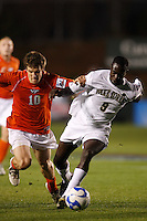 Virginia Tech Hokies midfielder Charles Campbell (10) defends Wake Forest Demon Deacons forward Marcus Tracy (9) during an NCAA College Cup semi-final match at SAS Stadium in Cary, NC on December 14, 2007. Wake Forest defeated Virginia Tech 2-0.
