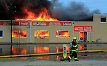 SEASIDE HEIGHTS, NJ (Sept. 12, 2013) - By 6:30 pm, firefighters put out an urgent call for additional manpower as the fire continues to burn north, destroying entire blocks of the Seaside Boardwalk.