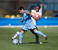 Jordan Cyrus (14) of Maryland fights for the ball with Danny Garcia (17) of North Carolina during the game at the Maryland SoccerPlex in Germantown, MD. Maryland defeated North Carolina, 2-1,  to win the ACC men's soccer tournament.