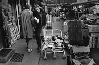 Twins sleep in a pram in London's Camden Town market.