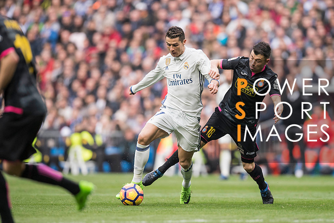 Cristiano Ronaldo of Real Madrid fights for the ball with Javi Fuego of RCD Espanyol during the match Real Madrid vs RCD Espanyol, a La Liga match at the Santiago Bernabeu Stadium on 18 February 2017 in Madrid, Spain. Photo by Diego Gonzalez Souto / Power Sport Images