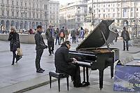 - Milan, street musician in Duomo Square<br /> <br /> - Milano, musicista di strada in piazza del Duomo