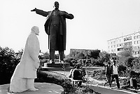 Kazakhstan. Semipalatinsk. A young couple seat on a bench, another couple walks on an alley in a public park near Lenin's statues from the former Soviet Union. Vladimir Ilyich Lenin ( born Vladimir Ilyich Ulyanov. April 22 [O.S. April 10] 1870  - January 21, 1924), was a Russian revolutionary, a communist politician, the main leader of the October Revolution, the first head of the Russian Soviet Socialist Republic and from 1922, the first de facto leader of the Soviet Union. Semey is the Kazakh name for Semipalatinsk and is located in the Eastern Kazakhstan Province. © 2008 Didier Ruef ...