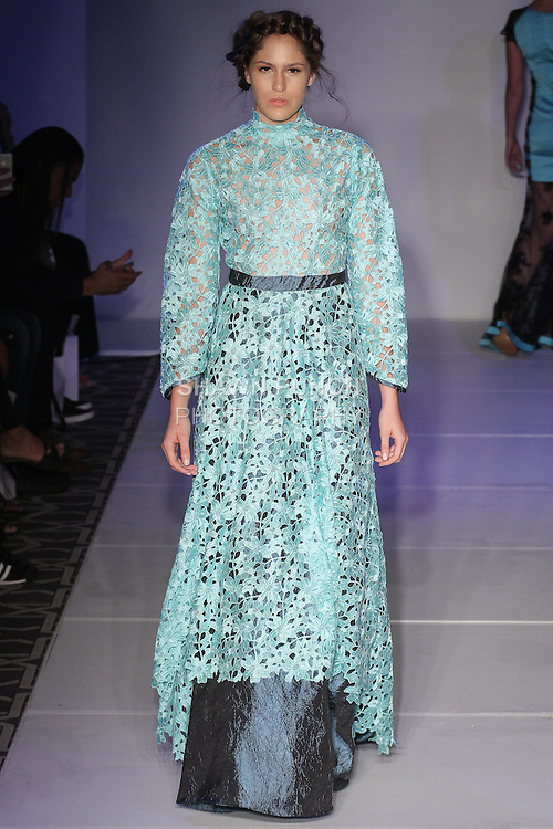 Model walks runway in an outfit from the Nahia Spring Summer 2016 collection by Daniela Pina, for the Emerging Designers fashion show, at Fashion Gallery NYFW Spring Summer 2016 show, during New York Fashion Week.