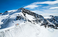 The Ortler Group in northern Italy is a popular region for spring ski touring using the huts for overnights to ski all the many peaks in the mountain group. Ski tourers on the Monte Cevadale - Monte Pasquale traverse.
