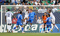 Cuba's Jeniel Marquez head a shot on goal while being defended by El Salvador's Victor Turcios.  El Salvador defeated Cuba 6-1 at the 2011 CONCACAF Gold Cup at Soldier Field in Chicago, IL on June 12, 2011.