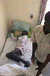 NOT MODEL RELEASED; FOR EDITORIAL USE ONLY... African man suffering with HIV Aids lying in bed at Mashambanzou Care Trust run by nuns, in Harare, Zimbabwe