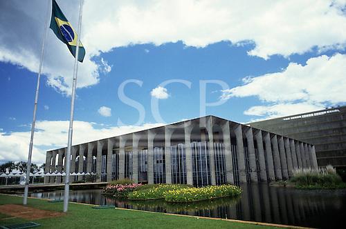 Brasilia, Brazil. Palace of Itamaraty (Foreign Ministry) by Oscar Niemeyer (architect) with the Brazilian flag.