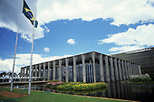 Brasilia, Brazil. Palace of Itamaraty (Foreign Ministry) by Oscar Niemeyer (architect) with the Brazilian flag.
