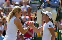 28-06-10, Tennis, England, Wimbledon,  Kim Clijsters(L) defeats   Justine Henin