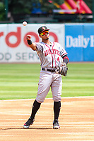 Quad Cities River Bandits shortstop Miguelangel Sierra (4) throws the ball around the infield between innings during a Midwest League game against the Kane County Cougars on July 1, 2018 at Northwestern Medicine Field in Geneva, Illinois. Quad Cities defeated Kane County 3-2. (Brad Krause/Four Seam Images)
