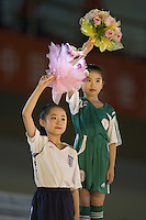 Children in the uniforms of the participating countries takes part in the opening ceremonies for the FIFA Women's World Cup at Hongkou Stadium in Shanghai, China.