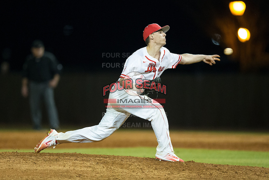 Belmont Abbey Crusaders relief pitcher Travis Block (28) delivers a pitch to the plate against the Catawba Indians at Abbey Yard on February 7, 2017 in Belmont, North Carolina.  The Crusaders defeated the Indians 12-9.  (Brian Westerholt/Four Seam Images)