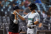 Surprise Saguaros Brewer Hicklen (23), of the Kansas City Royals organization, is congratulated by Bat Boy Danny Wood after hitting a home run to right field during an Arizona Fall League game against the Peoria Javelinas on September 22, 2019 at Peoria Sports Complex in Peoria, Arizona. Surprise defeated Peoria 2-1. (Zachary Lucy/Four Seam Images)