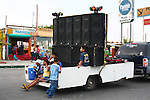 MEXICAN CHILDREN ON FLATBED WITH SOUND SYSTEM IN CARNIVAL PARADE