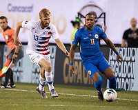 PHILADELPHIA, PA - JUNE 30: Gevaro Nepomuceno #11 dribbles the ball with Tim Ream #13 in pursuit during a game between Curacao and USMNT at Lincoln Financial Field on June 30, 2019 in Philadelphia, Pennsylvania.