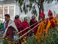 Bumthang, Bhutan.  Monks Playing Trumpets (Dung-chen) Entering Jambay Lhakhang Monastery.