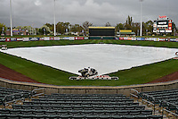 A tarp covered field during the rain delay as the Salt Lake Bees faced the Fresno Grizzlies in Pacific Coast League action at Smith's Ballpark on April 13, 2016 in Salt Lake City, Utah. The Grizzlies defeated the Bees 6-0. (Stephen Smith/Four Seam Images)
