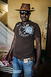 CAR, Bangui: Force Amimeri is posing in the headquarter of the Auto-Defense in the PK5 neighbourhood of Bangui. Force is the etat major of the auto-defense and pose often with his hats. 14th of April 2016<br /> <br /> RCA, Bangui : Force Amimeri pose dans le QG de l' Auto -défense dans le quartier  PK5 de Bangui . Force est l' Etat Major de l'auto- défense et pose souvent avec ses chapeaux.  14 Avril 2016