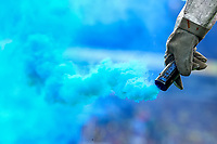 28th August 2021; Carrow Road, Norwich, Norfolk, England; Premier League football, Norwich versus Leicester; A smoke flare is taken away to be put out as Leicester fans celebrate Jamie Vardy scoring for 0-1