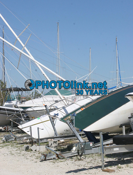 Miami Beach, FL 10-25-2005<br />Wrecked and sunk boats litter the landscape<br />around the Miami Yacht Club located on<br />Watson Island in Miami Beach<br />Digital Photo by ©Adam Scull-PHOTOlink.net<br />ONE-TIME REPRODUCTION RIGHTS ONLY