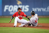 Erie SeaWolves shortstop Gustavo Nunez (12) attempts to tag Brandon Bednar (17) sliding in safely during a game against the Richmond Flying Squirrels on August 22, 2016 at Jerry Uht Park in Erie, Pennsylvania.  Erie defeated Richmond 4-2.  (Mike Janes/Four Seam Images)