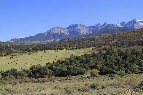 Ranch with bales of hay, Sneffels Range, Colorado John offers autumn photo tours throughout Colorado.