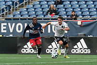 FOXBOROUGH, UNITED STATES - MAY 28: Ignacio Poplawski #34 of Fort Lauderdale CF dribbles as Michel #48 of New England Revolution II closes during a game between Fort Lauderdale CF and New England Revolution II at Gillette Stadium on May 28, 2021 in Foxborough, Massachusetts.