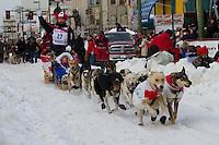 2010 Iditarod Ceremonial Start in Anchorage Alaska musher # 27 WARREN PALFREY with Iditarider DENALI ADAMS