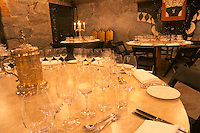 Tables set for a grand dinner and wine tasting with hundreds of wine glasses At the wine cellar storage company Grappe in Stockholm where private individual s can store and age wine bottles. Källaren Grappe Wine Storage Cellar, Stockholm, Sweden, Sverige, Europe