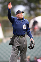 May 10, 2009:  Home plate umpire Fran Burke signals to the press box for a pitching change during a game at the Frontier Field in Rochester, NY.  Photo by:  Mike Janes/Four Seam Images