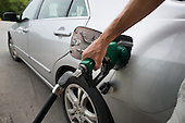 Fillin a car with petrol (gas), West Virginia, USA