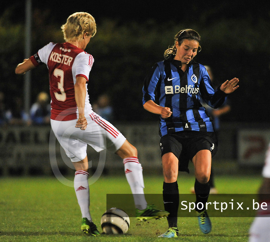 20130830 - VARSENARE , BELGIUM : Brugge's Nicky Van Den Abbeele pictured in a duel with Ajax' Daphne Koster (left) during the female soccer match between Club Brugge Vrouwen and Ajax Amsterdam Dames , of the first matchday in the BENELEAGUE competition. Friday 30 August 2013. PHOTO DAVID CATRY