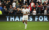 Pictured: Andre Ayew of Swansea thanks home supporters after the end of the game Sunday 30 August 2015<br />