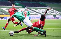 18th May 2020, WESERSTADION, Bremen, Germany; Bundesliga football, Werder Bremen versus Bayer Leverkusen;  Edmond Tapsoba Leverkusen tackles Davie Selke Bremen on the edge of the box