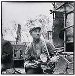 Li holding his Russian-made Kiev 35 mm camera and a German 6 x 6 Rolleiflex in Ashihe commune, Acheng county (photograph by Liu Guoqi). 12 May 1965