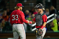 Worcester Red Sox pitcher Kaleb Ort (33) and catcher Chris Herrmann (18) after closing out a game against the Rochester Red Wings on September 3, 2021 at Frontier Field in Rochester, New York.  (Mike Janes/Four Seam Images)