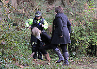 Pictured: Two young gilrs leaving floral tributes near the scene where the body of Rebecca Aylward was discovered. Monday 25 October 2010<br /> Re: 15 year old Rebecca Aylward has been found murdered in woodlands near Aberkenfig south Wales. Two fifteen year old men have been arrested. Aylward was originally from nearby Maesteg.