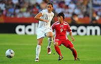 Alex Krieger (l) of Team USA and Ra Un Sim of Team North Korea during the FIFA Women's World Cup at the FIFA Stadium in Dresden, Germany on June 28th, 2011.