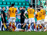 24th April 2021; Easter Road, Edinburgh, Scotland; Scottish Cup fourth round, Hibernian versus Motherwell; The referee on the scene to keep the peace between players