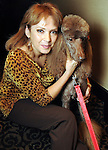 """Sandra Pulford with Madison at the """"Dog Days of Summer"""" Yappy Hour benefitting Citizens for Animal Protection and Golden Beginnings Golden Retriever Rescue at Hotel Derek Wednesday July 21,2010.(Dave Rossman/For the Chronicle)"""