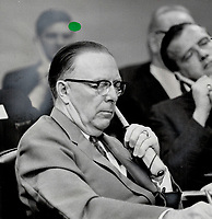 1967 FILE PHOTO - ARCHIVES -<br /> <br /> Alberta's Premier E. C. Manning, left, pays strict attention as Quebec's Premier Johnson at the Confederation of Tomorrow conference accuses certain unnamed premiers of trying to create the impression that it had been designed to meet Quebec's complaints with an aspirin. Manning, on the other side of the debate at the meeting, obviously was one of the men referred to.<br /> <br /> PHOTO :  Norman JAMES - Toronto Star Archives - AQP