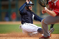 Detroit Tigers right fielder Tyler Collins (18) slides into third base during an exhibition game against the Florida Southern Moccasins on February 29, 2016 at Joker Marchant Stadium in Lakeland, Florida.  Detroit defeated Florida Southern 7-2.  (Mike Janes/Four Seam Images)