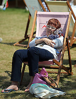 Hay on Wye. Sunday 05 June 2016<br /> A woman takes a nap on the green at the Hay Festival, Hay on Wye, Wales, UK
