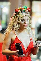 A young lady out in Wind Street, Swansea, Wales  on Mad Friday, Booze Black Friday or Black Eye Friday, the last Friday night before Christmas Day, when traditionally people in the UK go out to celebrate the start of their holidays. Friday 22 December 2017