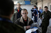 A young conscript waiting in line at the airforce base in Radom. This year's class of drafted recruits is the final one after 90 years of compulsory military service, as Poland's army turns professional in 2009.