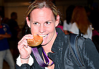 August 09, 2012: Christie Rampone bites on the Gold Medal on her way to the team bus at the conclusion of women's Football Final match at the Wembley Stadium on day thirteen in Wembley, England. USA defeat Japan 2-1 to win it's third consecutive Olympic gold medal in women's soccer. ..