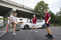 NASHVILLE, TN - SEPTEMBER 5: USA Fans kick a soccer ball during an American Outlaws tailgate before a game between Canada and USMNT at Nissan Stadium on September 5, 2021 in Nashville, Tennessee.