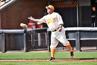 Tennessee Volunteers head coach Dave Serrano (18) throws the resign bag to the mound before game one of a double header against the UC Irvine Anteaters at Lindsey Nelson Stadium on March 12, 2016 in Knoxville, Tennessee. The Volunteers defeated the Anteaters 14-4. (Tony Farlow/Four Seam Images)